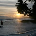 Walking through surf along the wild Pacific Ocean beach near the El Remanso Lodge, Costa Rica. © Daniel Beltrá