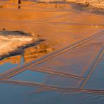 Reflection of sunrise on sandstone cliffs, Winter, Arches National Park, Utah.