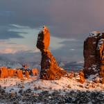 Balanced Rock and snow at sun set, Arches National Park, Utah. Winter.